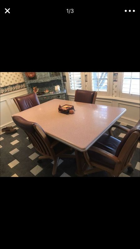 Corian kitchen table with wood base and 4 all leather chairs with corian kitchen table with wood base and 4 all leather chairs with rollers table is heavy and sturdy the leather chairs are very comfy watchthetrailerfo
