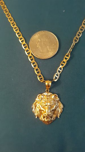Photo 10k necklace real gold 24 inches and 10k lion charm 11 grams everything