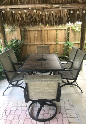 Outdoor Table 4 chairs & 2 swiveling rockets for Sale in Miami, FL