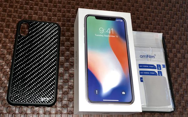 size 40 41c08 d6111 $650 Firm - iPhone X 256gb Silver with Simply Carbon Fiber Case and Screen  Protectors for Sale in Morton Grove, IL - OfferUp