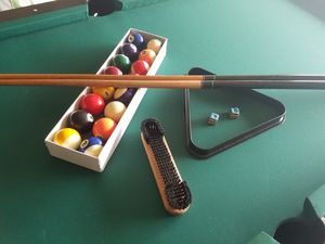 Pool table and Air hockey in 1 Air hockey work pool table comes with 2 sticks and 16 balls + cubes for Sale in Las Vegas, NV