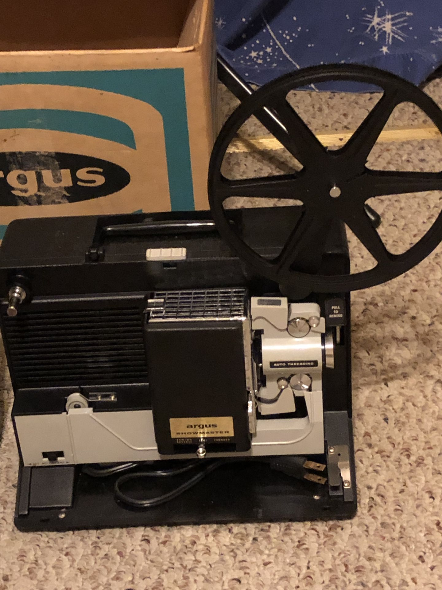 8 mm Argus Showmaster movie projector and screen.