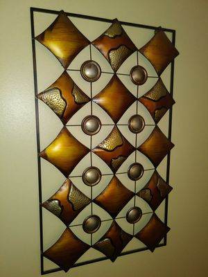 Matching pair of metal 3-D wall art for sale for Sale in St. Louis, MO