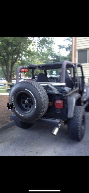 Jeep 1999 título limpio en buen estado millaje 153 estándar for Sale in Washington, DC