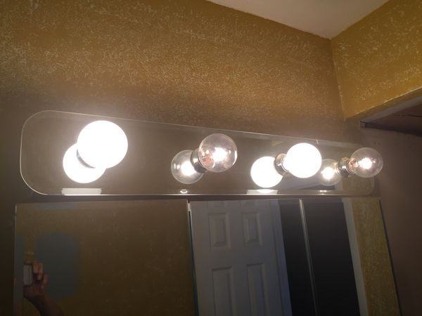 Medicine cabinet and light. Light 3 ft by 6 inches. Cabinet 3 ft ...