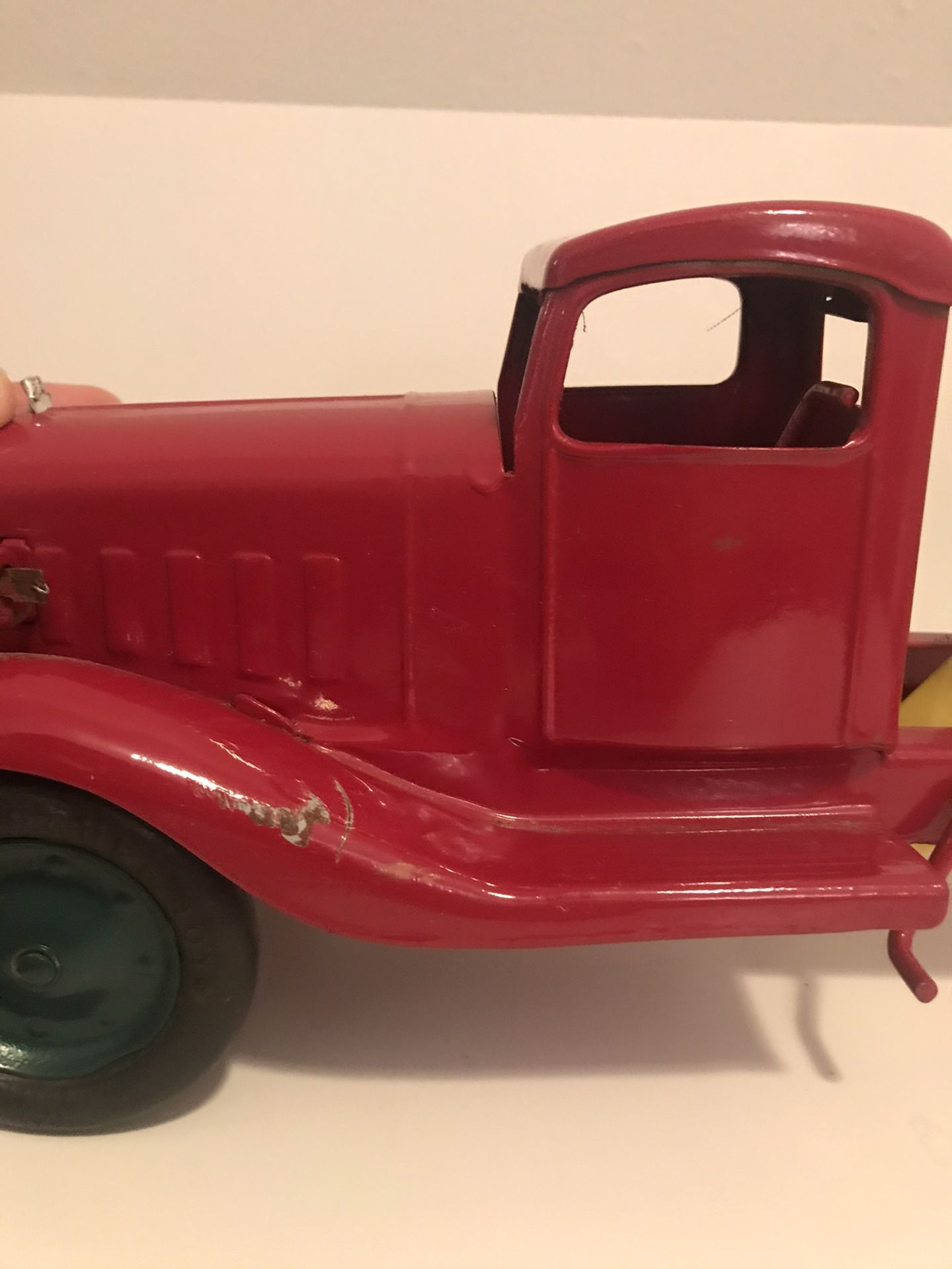 Vintage and Rare Turner Toys Pressed Metal Red and Yellow Dump Truck with Battery Slot for Working Headlights 18in Length 6in Height Normal Wear Rubb