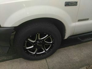 20 by 9 Moto Metal rims with tires bolt pattern 8x170 with + 18 offset came off a 03 F250 for Sale in Nashville, TN