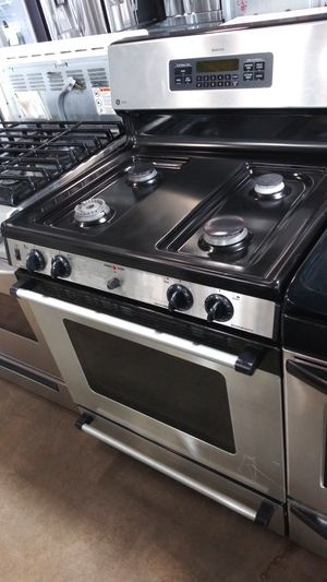 Photo GE Stainless and Black Gas 4 Burner Stove