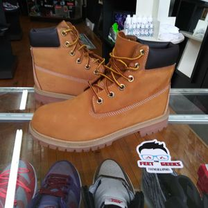 Photo KIDS TIMBERLAND BOOTS SIZE 4.5 Y EXCELLENT USED CONDITION $65