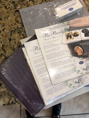 Scrapbook, pages, protectors, cutting tool mat ovals NEW for Sale in Laveen Village, AZ