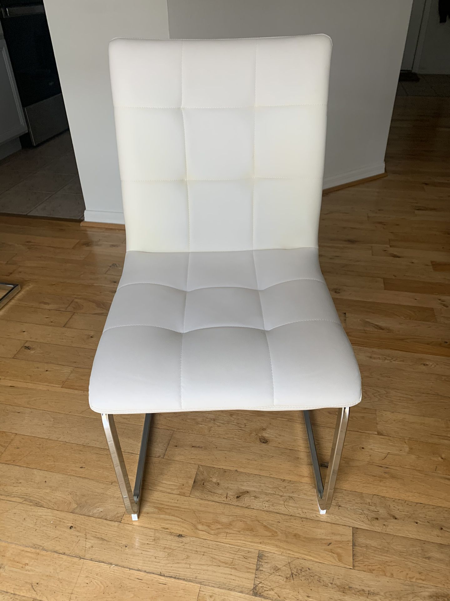 4 White Leather dining room chairs in great condition