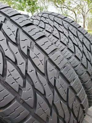 Photo (2) 265-75-16 Tires (SEMI NEW)