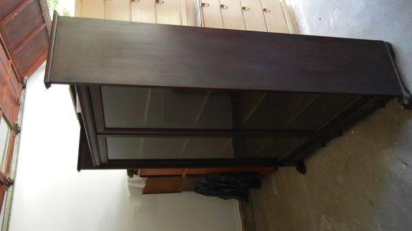 Antique China cabinet display cabinet. Dark Walnut glass doors claw foot.  Excellent condition (Antiques) in East Williston, NY - OfferUp - Antique China Cabinet Display Cabinet. Dark Walnut Glass Doors Claw