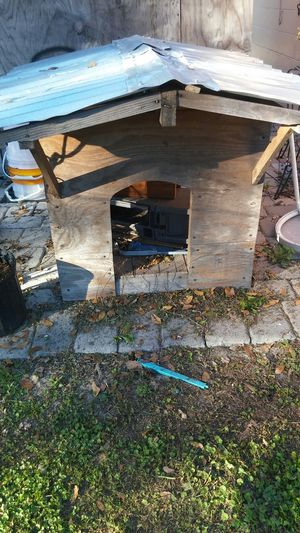 Out door dog house just need 2pieces of ply board but if you want i can knock them on for Sale in Orlando, FL