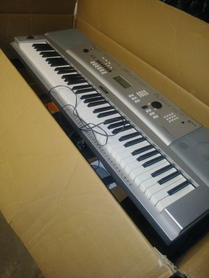Yamaha Portable Grand Digital Keyboard with charger stand and also music book holder for Sale in Camden, NJ
