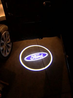 Ford car door light shines on the ground automatically when you open your door for Sale in Whittier, CA