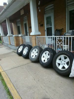 Jeep factory rims and fair condition tires for Sale in Pittsburgh, PA