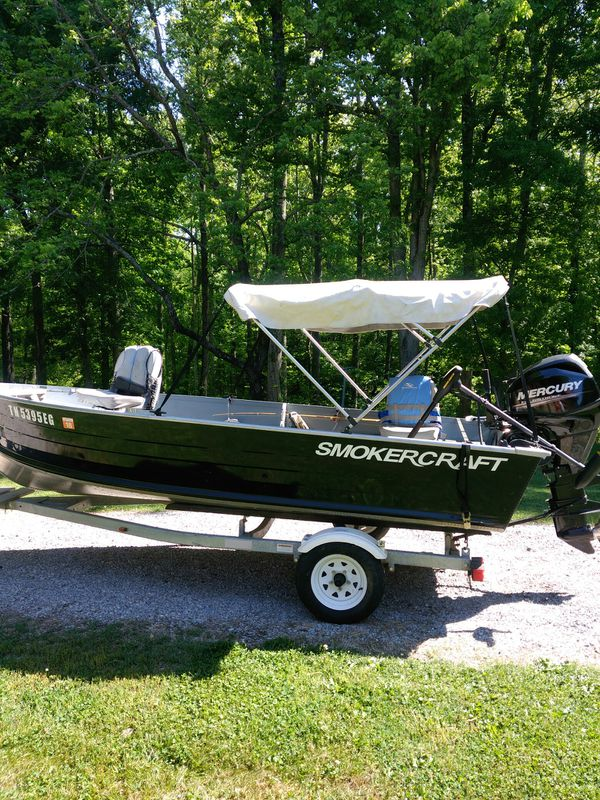 2012 14 foot smokecraft boat and trailer and 2015 25hp mercury motor 4 stroke