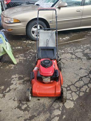 Photo Red honda troy built push lawn mower