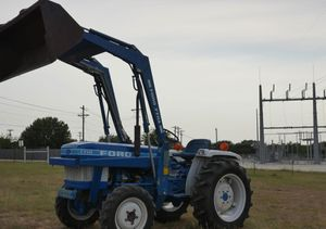 1710 Ford with-Bucket 770a for Sale in Dallas, TX