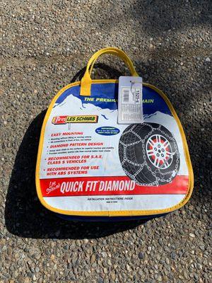 Photo Les Schwab quick fit diamond tire chains. 1525-s