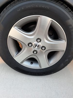 Photo 15 inch Honda Civic 2003 4 rims with new tires