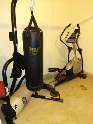 Elliptical & punching bag for Sale in Frederick, MD