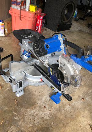 """Photo Kobalt 10"""" sliding mitre saw with lazer"""