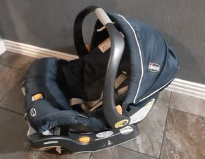 Photo Chicco car seat and base very clean and washed it has extra sunroof protection