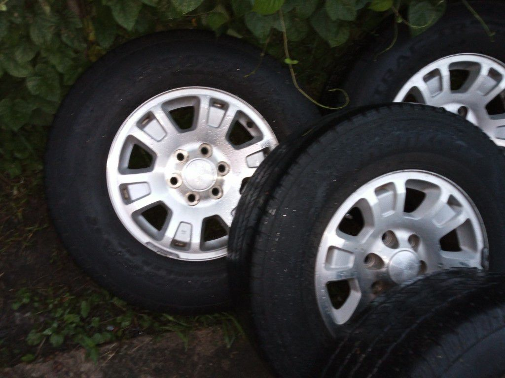 Used but look new tires for Chevy Silverado or GMC