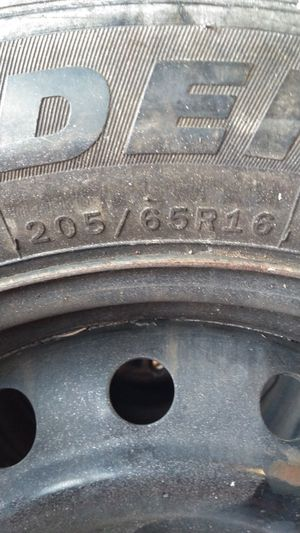 Photo 2 wheels, excellent tread, 205/65/16 off a Chevy, 5 lug