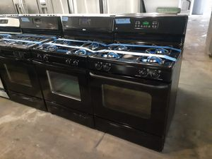 Photo GE black gas stove working perfectly with 4 months warranty