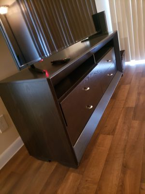 Photo Black tv stand living room table with drawers.. great condition.. only $150