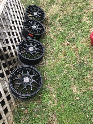 "Photo Set of wheels 15"" universal 4 lugs for car"