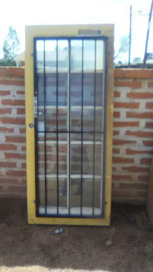 2 Metal Doors 1 Wood Door With Glass Panes And Security Bars For