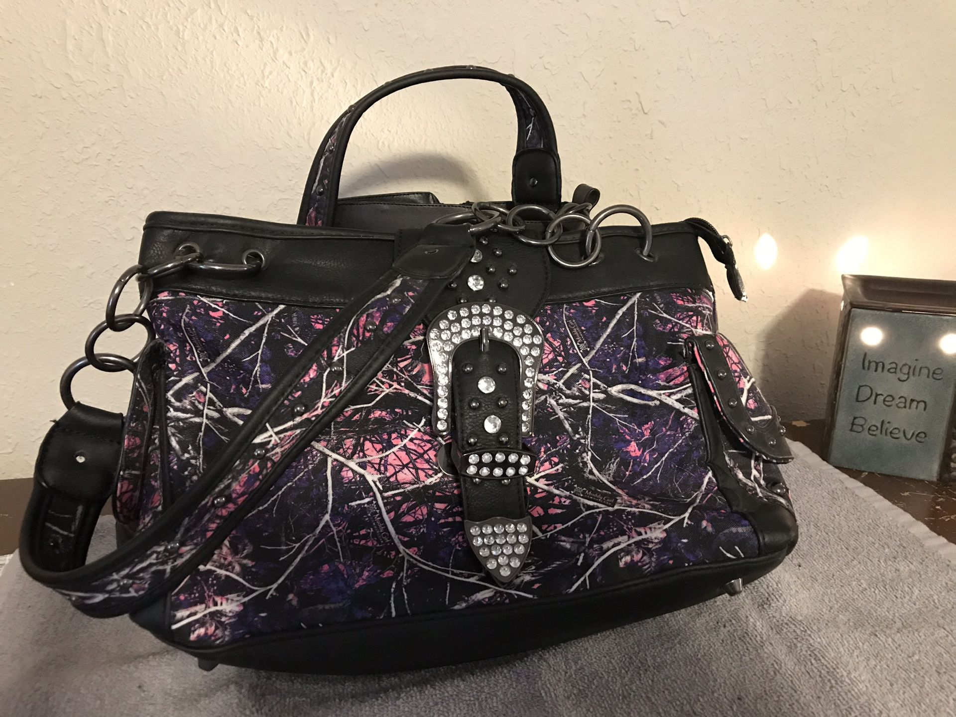Pink camo conceal carry purse