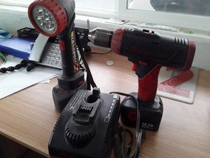 Photo 14 volt snap-on drill and light with rapid charger and two batteries