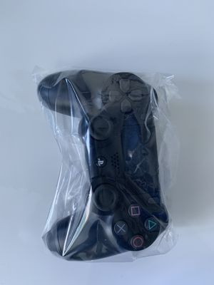 Black Sony PS4 controller that came with PS4 Slim - Never Used for Sale in Miami, FL