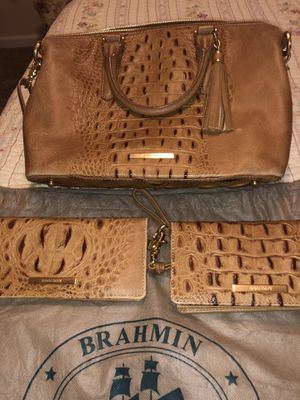 Photo Brahmin bag with wallet and wristlet with dust bag this is over 800.00 in like new condition asking 350.00 for all