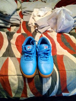 Photo Nice Fila Tennis shoes size 10.5 good condition asking 40 worn a few times good condition
