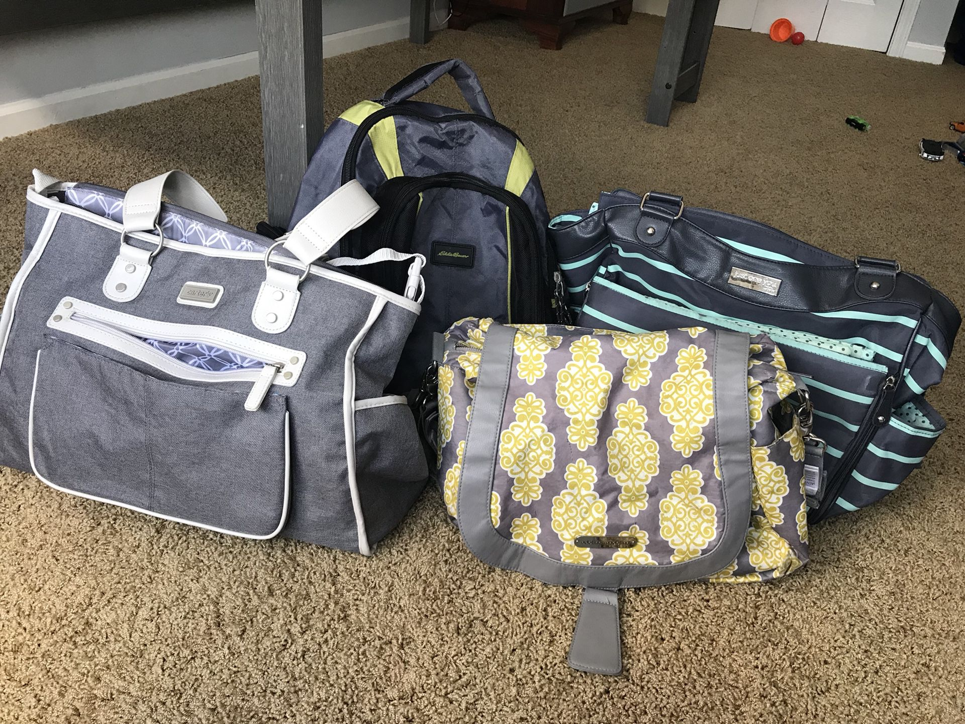 Baby diaper bags and changing pads