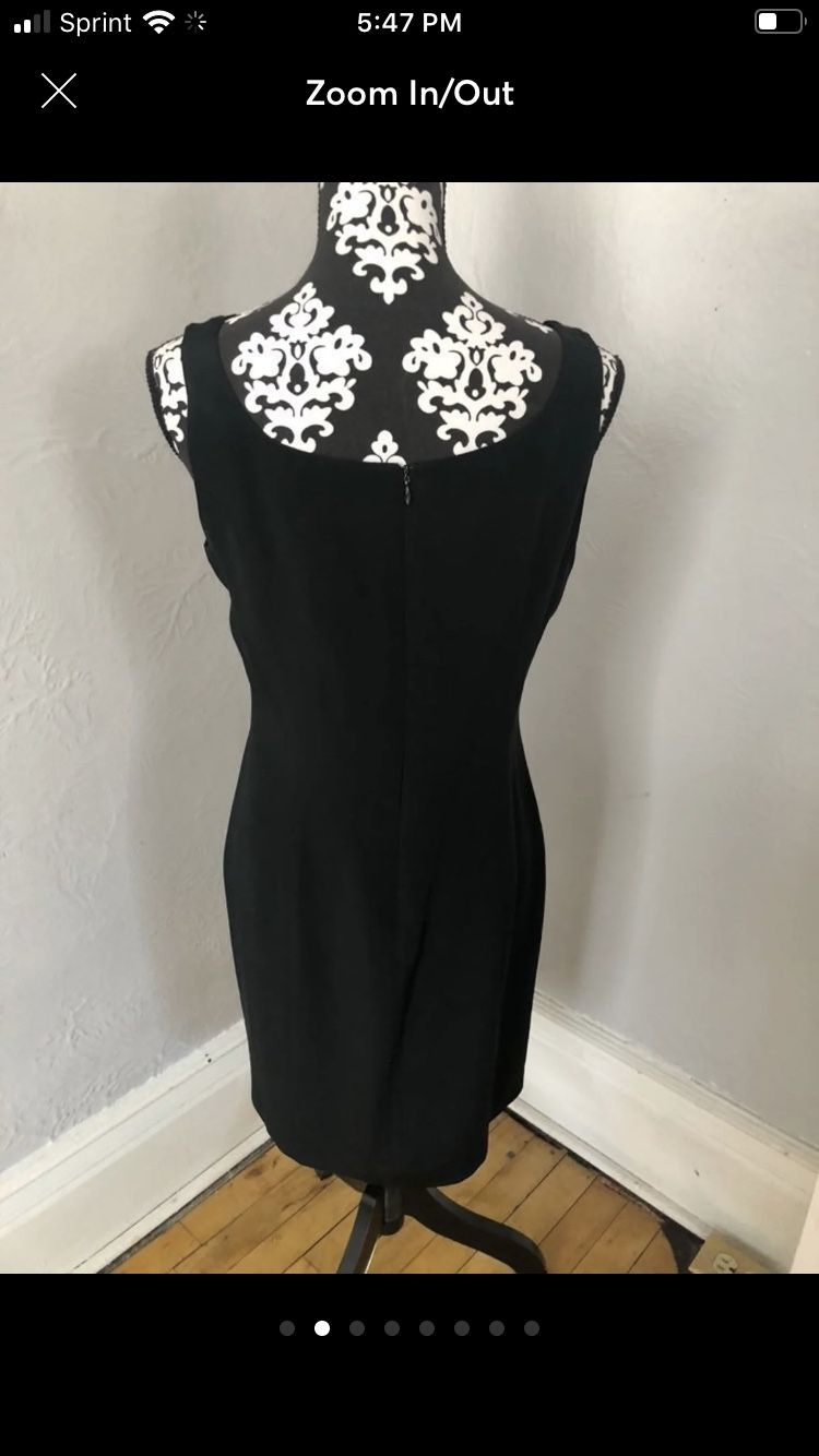 100% SILK Hugo Buscati little black dress loaded with Taylor designs including darts down the back and the front to enhance fitting, A hidden zipper