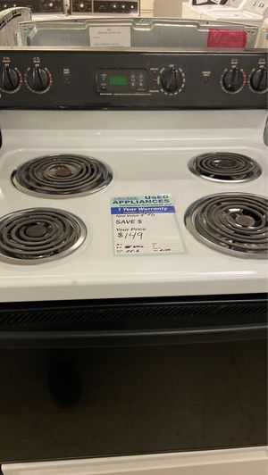 Photo Ge black/white coil top stove works great