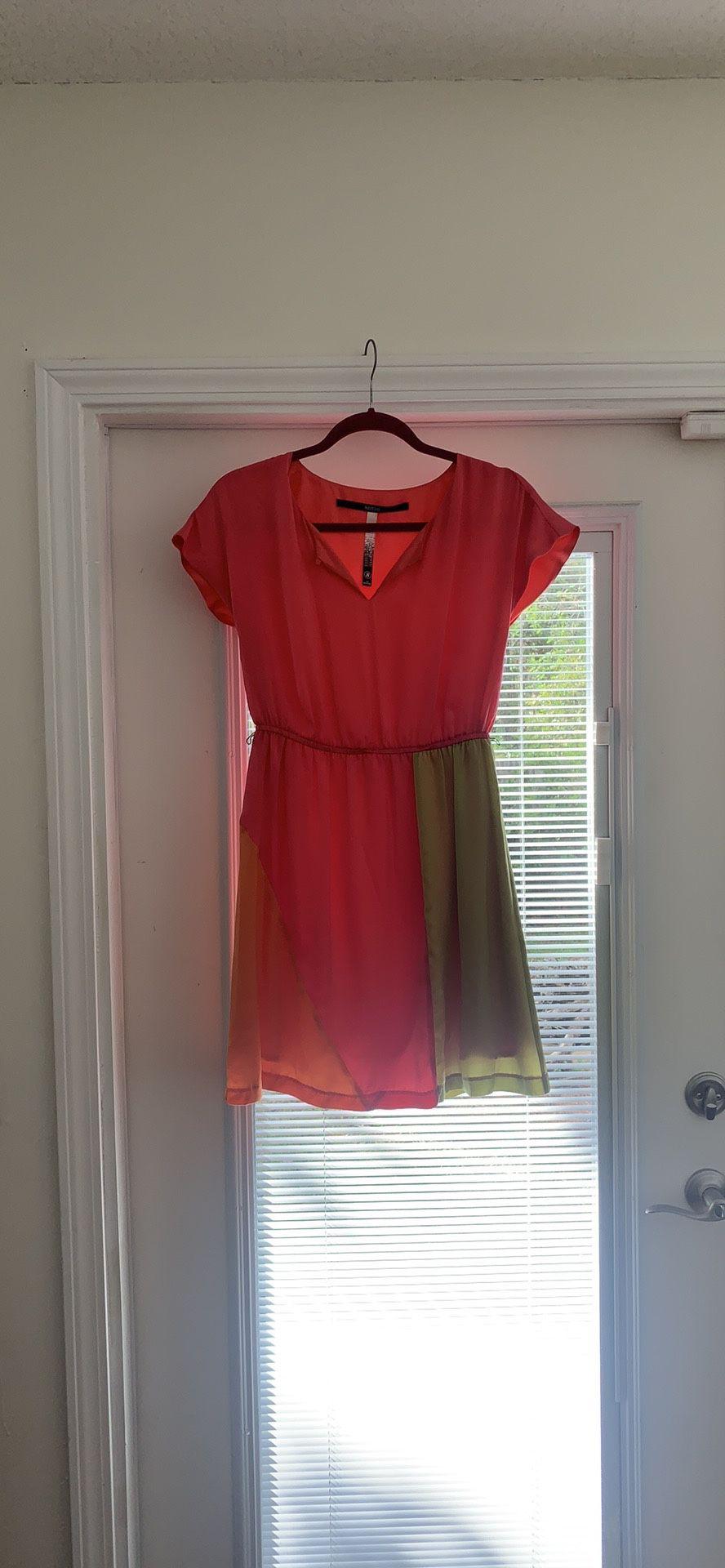 Short pink dress.
