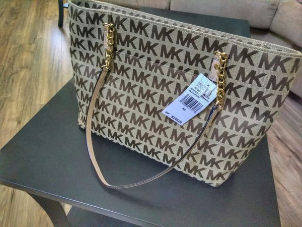 e14eb080f6f446 MICHAEL KORS Jet Set Chain Item MK Signature Jacquard With Chain/Leather  Straps EW Tote for Sale in Orlando, FL - OfferUp