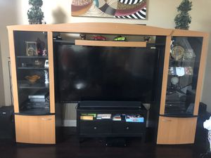 Photo Entertainment center adjustable from 35 inches to 80 inches!