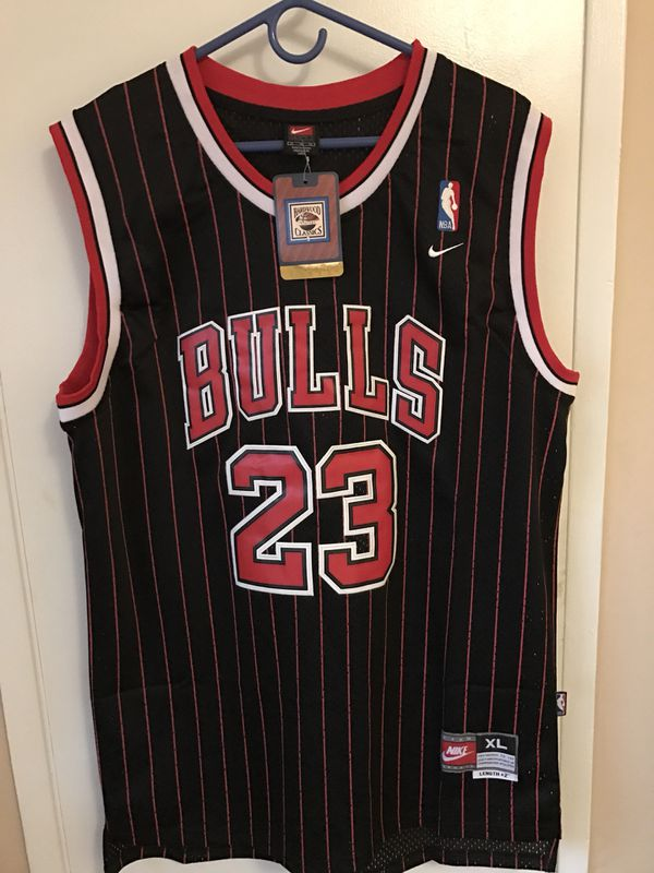 9fc183eaf65 Michael Jordan  23 black with red pinstripes Chicago bulls jersey ...
