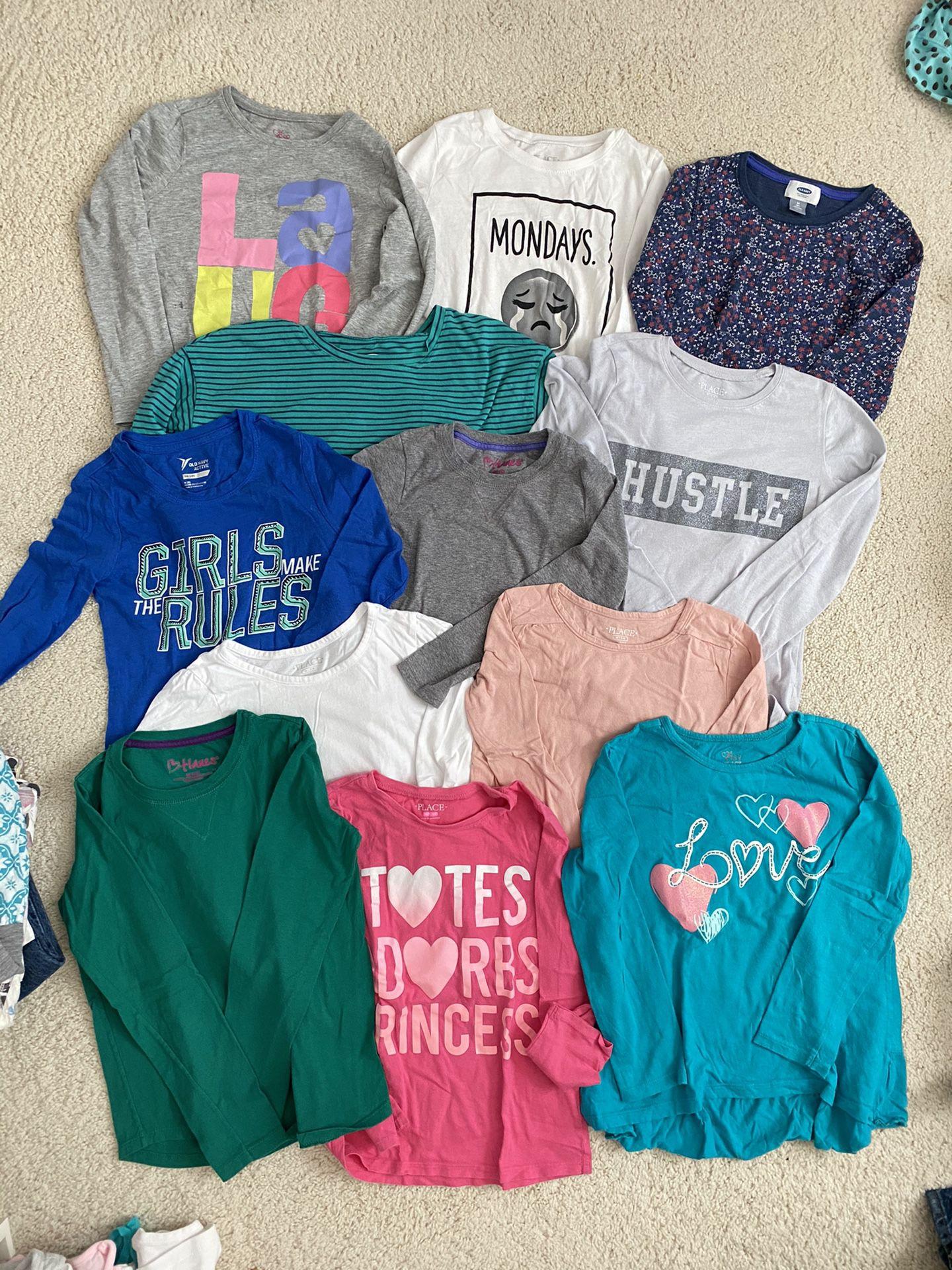 Girls long sleeve shirts, sizes 7-8, $1 each
