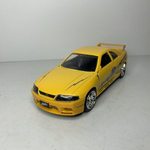 Photo NEW 1995 Yellow Nissan Skyline GT-R Japanese Street Racing Car Toy Diecast Metal Model Vintage 1990s Classic Used in the Movie The Fast and the Furio