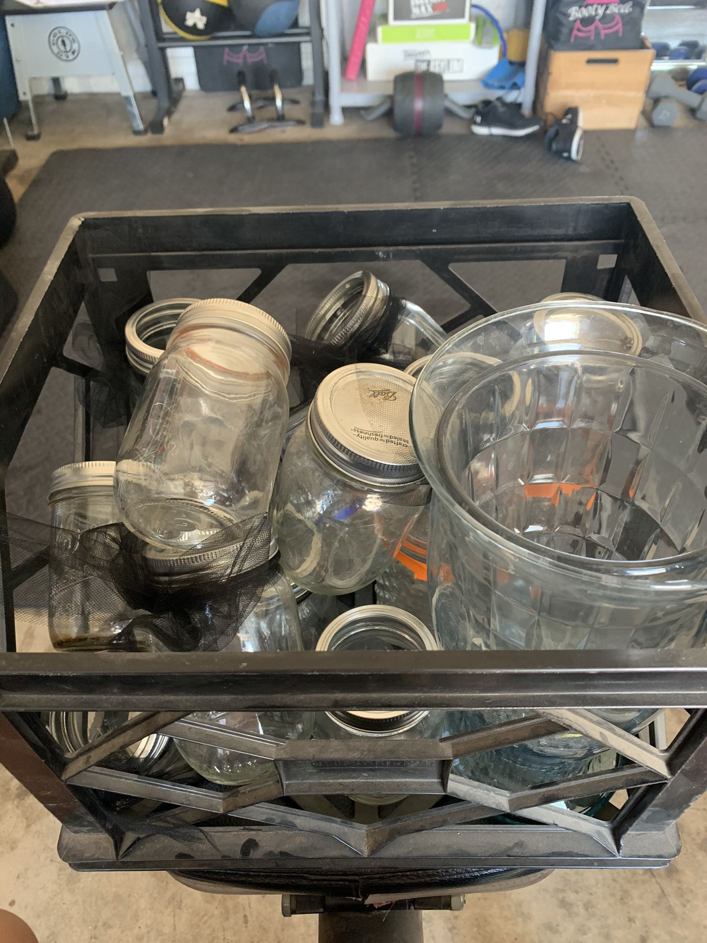 Crate of multiple mason jars and other glassware